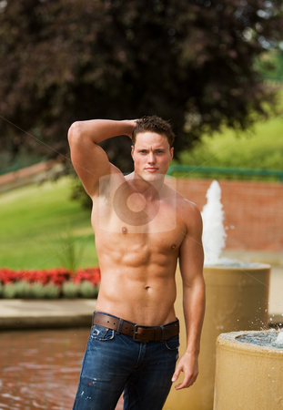 Healthy male model stock photo, A male model outside beside a water fountain by Steve Mcsweeny