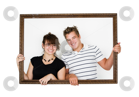 Framed couple stock photo, Young smiling couple in a picture frame by Steve Mcsweeny