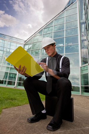 Foreman stock photo, A young business man reading plans outside by Steve Mcsweeny