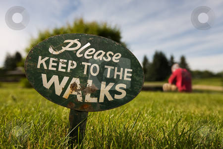Ignore the rules stock photo, Sign in the grass with a man in the background breaking the rules by Steve Mcsweeny