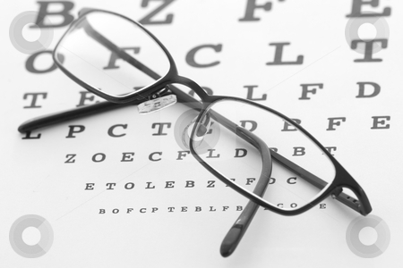 Eye care stock photo, Glasses and eye test chart by Steve Mcsweeny