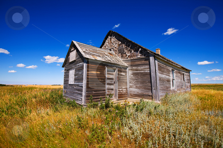 Wooden church stock photo, Old wooden church abandoned in a prairie field by Steve Mcsweeny