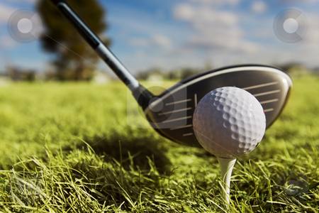 Golf drive stock photo, A golf ball and driver with focus on the ball by Steve Mcsweeny