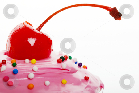 Cherry on top stock photo, A macro shot of a cherry on top of a cupcake by Steve Mcsweeny