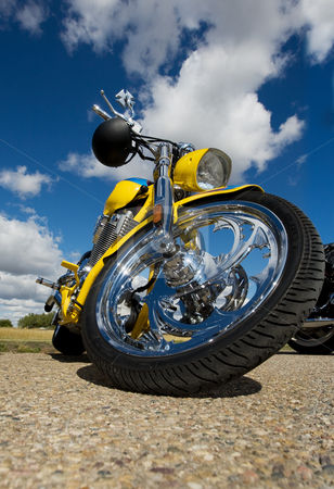 Yellow chopper stock photo, A yellow custom made motorcycle parked by Steve Mcsweeny