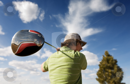Golf driver stock photo, A golfer swinging a large wood (focus on golf club) by Steve Mcsweeny