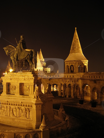 St. Stephen's statue stock photo, Night shot of the bronze statue of St. Stephen near the Fishermen's bastion on the hill of Buda by Alessandro Rizzolli