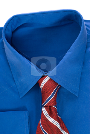 Shirt and Tie stock photo, Closeup view of a blue dress shirt and a red tie isolated against a white background by Richard Nelson