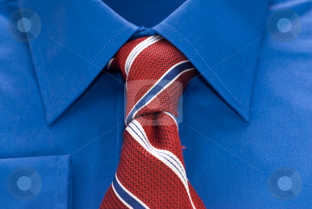 Shirt and Tie stock photo, Closeup view of a blue shirt and a striped tie by Richard Nelson