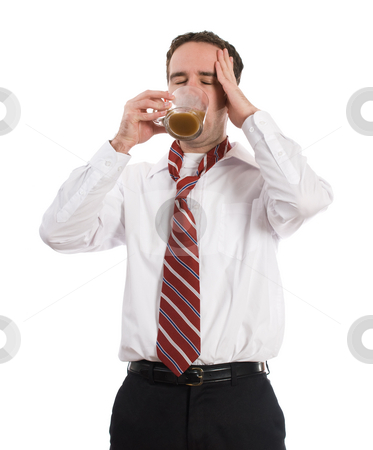 Caffeine Headache stock photo, A young coffee adict solving his caffeine headache by drinking another cup of coffee, isolated against a white background by Richard Nelson