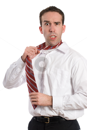 Stressed Businessman stock photo, A stressed businessman is pulling on his tie and getting mad, isolated against a white background by Richard Nelson