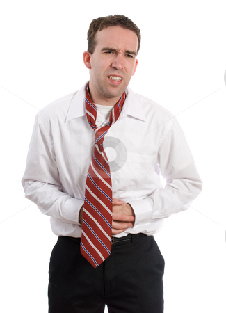 Businessman With Diarrhea stock photo, A young business employee holding his stomach in pain, isolated against a white background by Richard Nelson