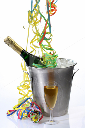 Partytime stock photo, Champaigne bottle in a cooler with ice on bright background by Birgit Reitz-Hofmann