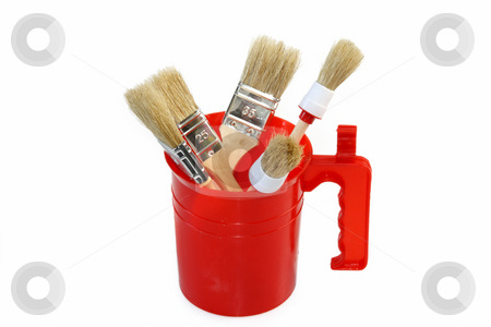Painting brushs stock photo, Painting brushs in a red pot isolated on white background by Birgit Reitz-Hofmann