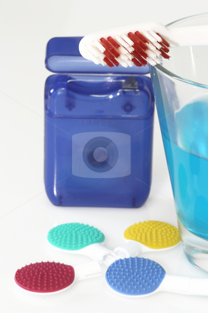 Tongue cleaner stock photo, Tongue cleaner and dental care products in detail by Birgit Reitz-Hofmann