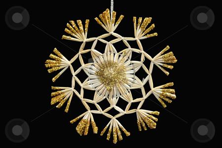 Straw star stock photo, Decorative straw star isolated on black background by Birgit Reitz-Hofmann
