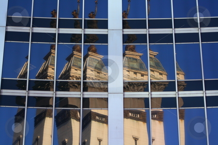 City monument reflection stock photo, Monument circle statue reflecting off of a tower in downtown Indianapolis Indiana by Chris Torres