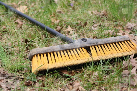 Broom in the grass stock photo, A large utility broom laying in the grass by Chris Torres
