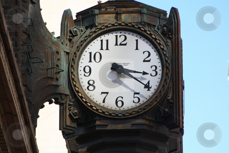 Clock on a building stock photo, A clock on the side of a building in downtown Indianapolis, In by Chris Torres