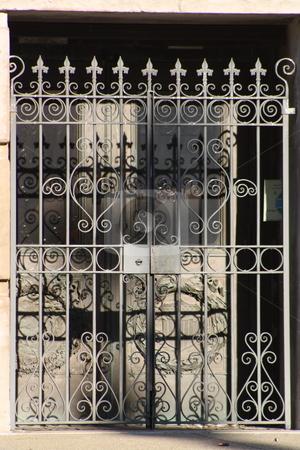 Steel gate stock photo, A steel gate across a door by Chris Torres