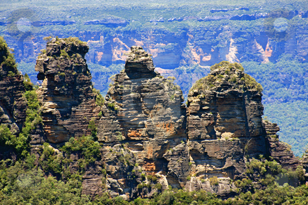 The Three Sisters. stock photo, An iconic rocky outcropping in the Blue Mountains of NSW, Australia  known as the 'Three Sisters' derived from aborginal myth. by Adam Goss