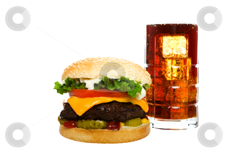 Cheeseburger With Cola stock photo, Juicy Angus beef burger topped with cheese, tomatoes & lettuce on a golden sesame seed bun along with a cool glass of cola on ice.  Shot on white background. by Brenda Carson
