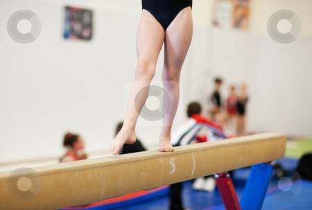 Gymnastics stock photo, A gymnastics competitor on the balance beam. by Brenda Carson