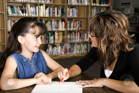 Student Teacher Relationship stock photo, A elementary teacher spending some one-on-one time with her student. by Brenda Carson