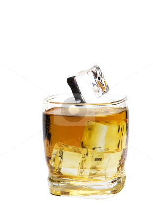 Whiskey on the Rocks stock photo, An ice cube about to fall into a glass of whiskey on the rocks.  Shot on white background. by Brenda Carson