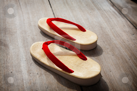 Japanese Sandals stock photo, A pair of Japanese sandals on a wooden floor. by Brenda Carson