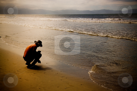 Beachcomber stock photo, A Beachcomber spends the evening searching for treasures washed up by the incoming tides.  Puerto Vallarte, Mexico. by Brenda Carson