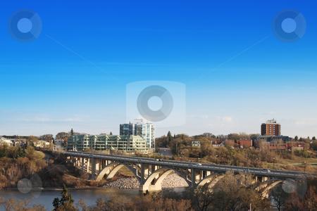 Good Morning Saskatoon stock photo, The city of Saskatoon, Saskatchewan, Canada.  A morning view of the Victoria Bridge in early spring. by Brenda Carson