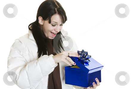 Surprise Christmas Gift stock photo, A surprised girl opening her Christmas gift. by Brenda Carson