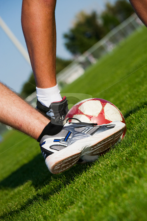 Soccer Feet stock photo, Two men's feet fighting for the soccer ball. by Brenda Carson