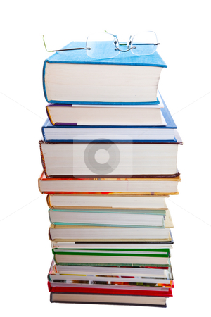 Reading stock photo, A stack of books with a pair of reading glasses on top. by Brenda Carson