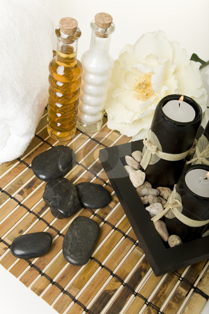 At the Spa stock photo, Spa products with massage stones, & aromatic candles. by Brenda Carson
