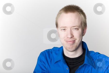 Male Pattern Baldness stock photo, A young man in his early twenties, already showing signs of male pattern baldness. by Brenda Carson
