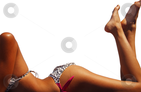 Tanning Isolated stock photo, A tanning woman's body frames the copy space.  Isolated with clipping path. by Brenda Carson