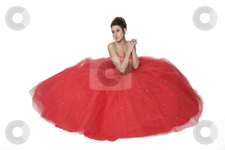 Belle of the Ball stock photo, Teenage girl posing in her graduation/prom gown against a white background. by Brenda Carson