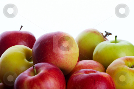 Apple Background stock photo, A bunch of fresh picked orchard apples.  Shot on white background. by Brenda Carson