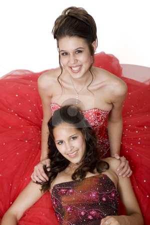 Formal Friends stock photo, Two friends, who are often mistaken for sisters, in formal attire, ready for their prom. by Brenda Carson