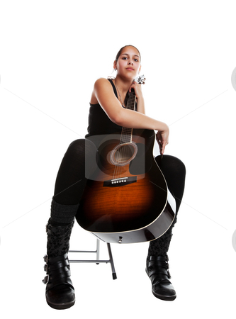 Solo Guitarist stock photo, A young mixed-race girl with her acoustic guitar.  Shot on white background. by Brenda Carson