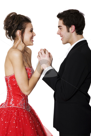 Young Love stock photo, First love.  Boy & girl, in formal attire, holding hands & smiling at each other. by Brenda Carson