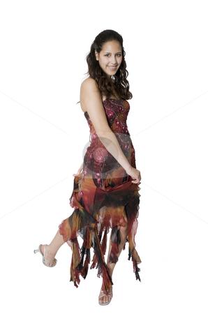 Swirling Skirt stock photo, A teenage girl swirls around to show off her graduation/prom dress. by Brenda Carson