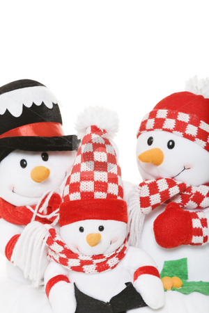 Snowman Family Christmas stock photo, A snowman family dressed in winter attire. by Brenda Carson
