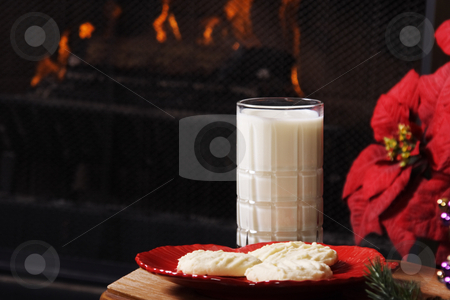 Cookies For Santa stock photo, Christmas Eve scene.  Shortbread cookies and milk set out by the fireplace, in preparation for Santa's arrival. by Brenda Carson