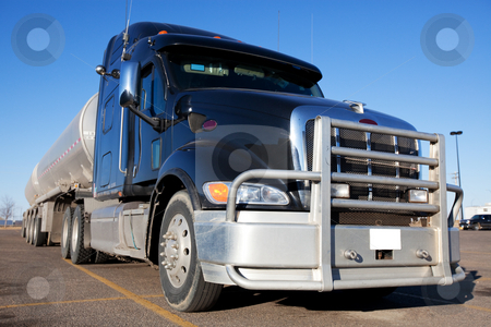 Fuel Truck stock photo, A blue fuel truck with two tanks behind. by Brenda Carson