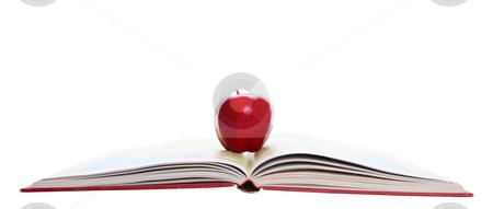 Red Apple on Atlas stock photo, A rosey, red apple on a school atlas. by Brenda Carson