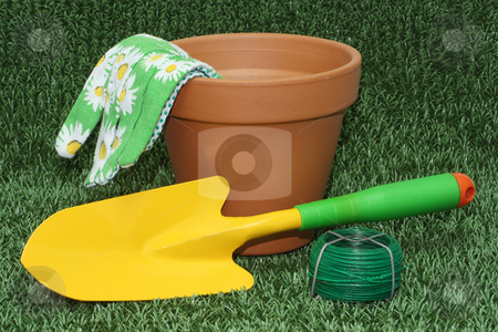 Gardening tools stock photo, Gardening tools and a flower pot on green grass meaadow by Birgit Reitz-Hofmann