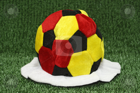 Soccer cap stock photo, Soccer cap in german flag colors on green background by Birgit Reitz-Hofmann